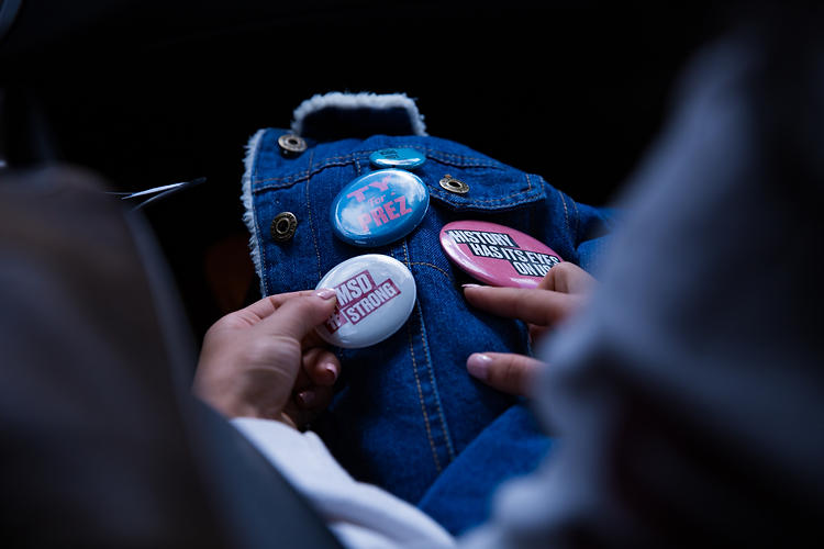 "Ruth pinned the buttons representing Stoneman Douglas' spirit to a jean jacket that was her roommate's gift. Though people in Syracuse showed sympathy, Ruth felt most comfortable confiding in with her friends from home who share and understand what she goes through. ""The people we trusted most with what we felt, and who would understand it most, is who we turned to."""
