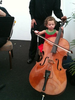 Julie's daughter holding Cello