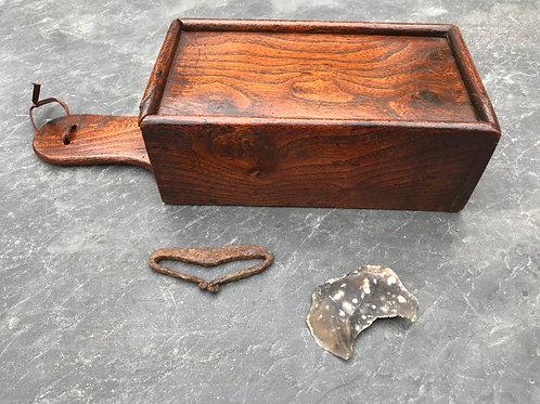 An 18th century elm antique tinder box