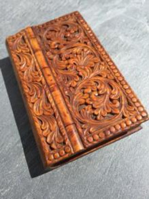 A  carved 19th century antique treen snuff book