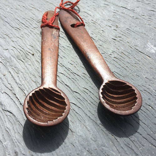 A Pair of Antique Treen Butter Shapers