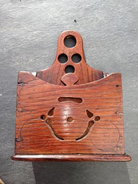 An Antique Oak candle/wall pocket