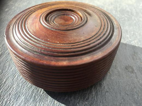 An early 19th century yew wood snuff box
