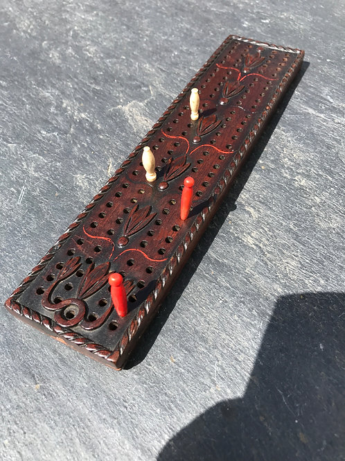 An Antique Mahogany Cribbage Board