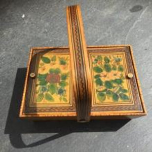 An early 19th century painted sewing basket