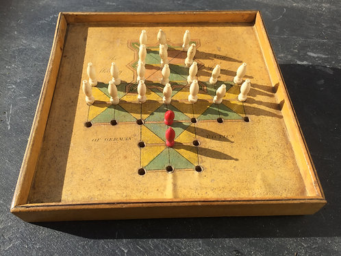 An Antique White Wood Game of inequality