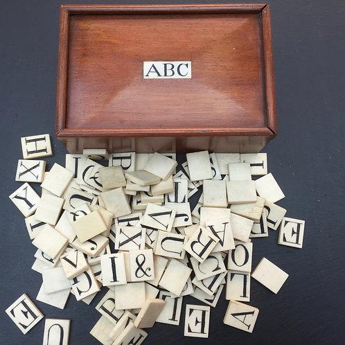 Antique Bone alphabet set in Mahogany Box
