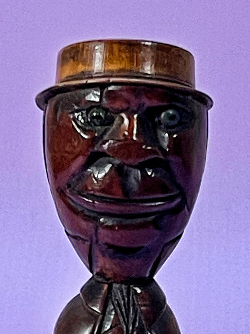 An Extra Large Fiqural Coquilla Nut Snuff Man