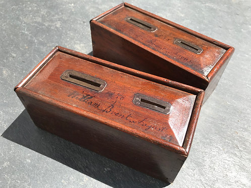 A Pair of mahogany money boxes - dated 1848
