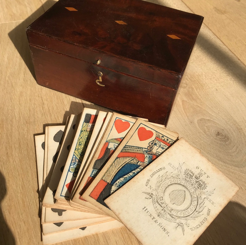 antique card box with playing cards for