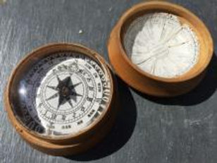 A 19th century sundial and compass
