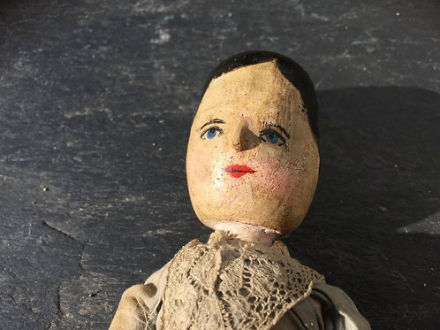 A late 19th century Grodnertal wooden peg doll