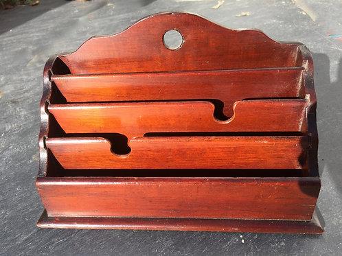 A mid 19th century mahogany stationery rack