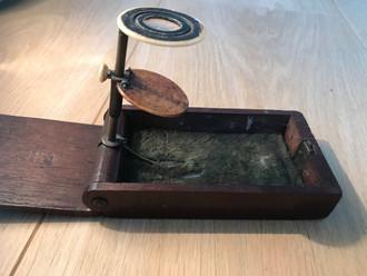 A Folding Pocket Microscope