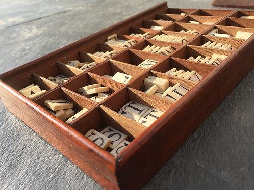 An Antique Mahogany and Bone Alphabet set
