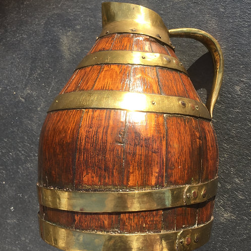 An Antique Oak Wine Jug