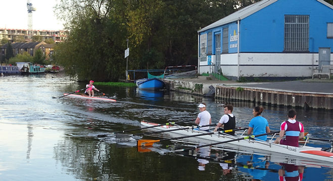 a single scull and quad on the River Lea