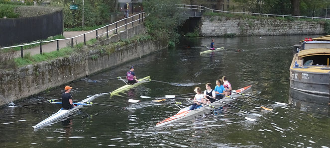 Rowers navigate a narrow section of River Lea