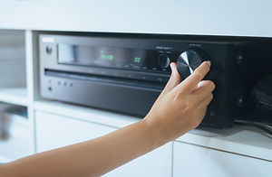 Hand turning on Home-theater amplifier s