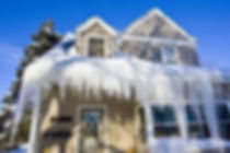 House Roof with Heavy Snow in Stamford, CT