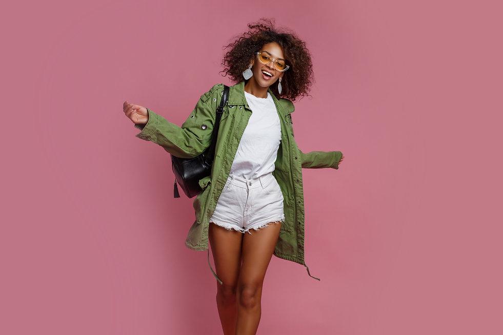 joyful-black-woman-having-fun-studio-pin
