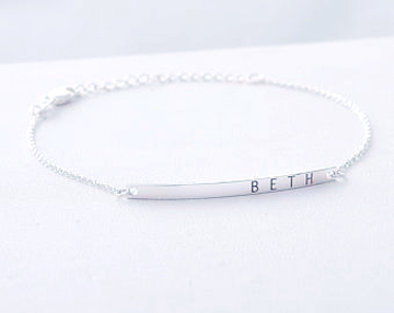 Silver jewelry laser engravings.