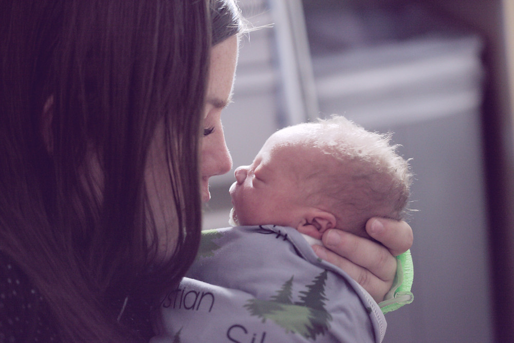 Woman seeks online counseling for postpartum depression shortly after having a baby. Catalyss Counseling provides treatment for postpartum depression in Colorado through online therapy and in person counseling in the Denver area 80209 and 80210