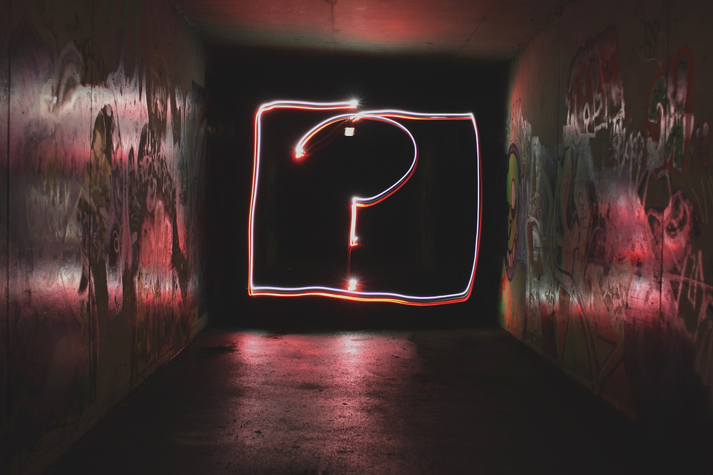 Question mark in pink on a black background signifying asking the question of how to find a good therapist in Denver CO. We offer 5 therapists to choose from at Catalyss Counseling to help you balance your life for counseling in Englewood CO 80209 and 80210