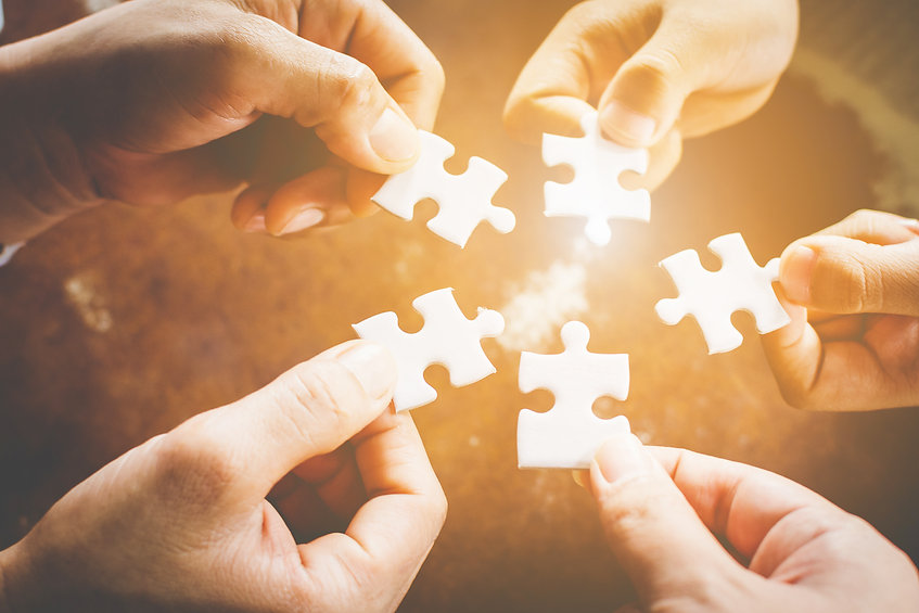 "Fingers holding puzzle pieces moving together as a team with an approved clinical supervisor in Denver, CO. The text ""Professional growth for therapists"" in Colorado is overlay. You can get professional counseling supervision for licensure here in the Denver, CO area!"