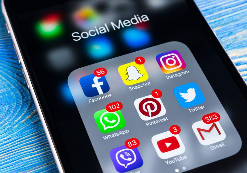 Mobile phone with Social Media Apps showing encouraging millennials to limit their social media consumption during coronavirus in Colorado. Our compassionate and caring therapists provide anxiety treatment at Catalyss Counseling in Denver CO 80209 and 80210