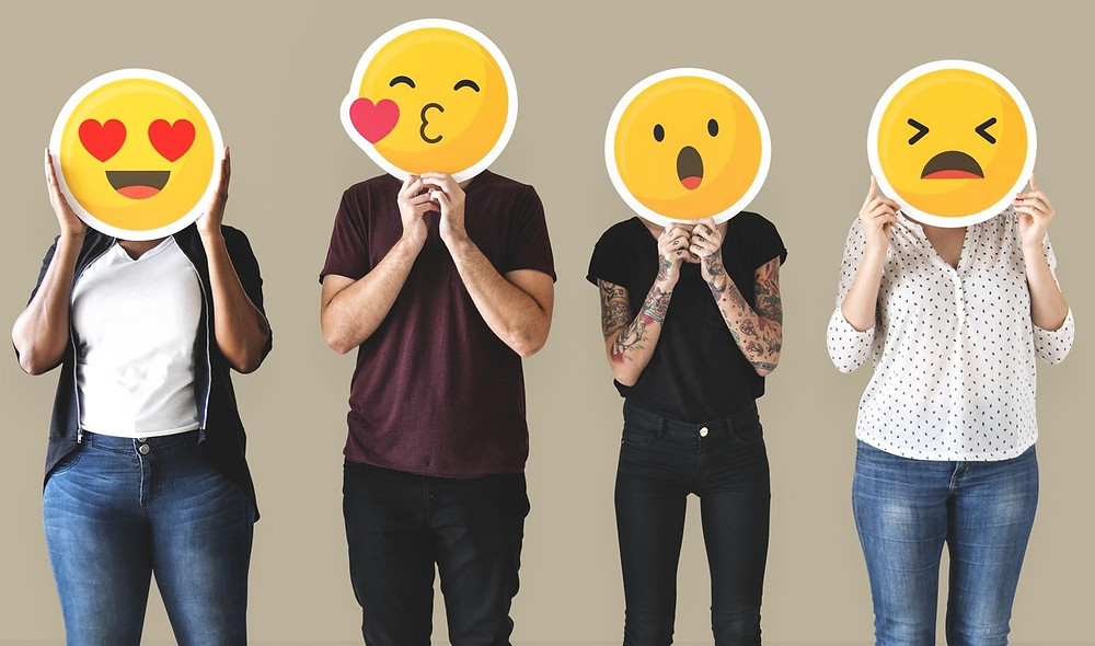 4 people holding different emoji signs over their faces to signal different emotions. Get treatment for anxiety and intense emotions at Catalyss Counseling in Colorado. We are located in Englewood CO and serve the Denver area 80209 and 80210