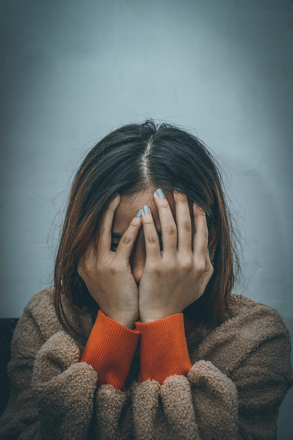 Millennial suffers from anxiety during Covid.Catalyss Counseling provides treatment for depression and anxiety in Colorado through online therapy and in person counseling in the Denver area 80209 and 80210