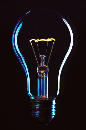 Lightbulb with a black background, signifying learning about Catalyss Consulting's Business Consultation Groups for counseling private practice owners to improve their business and marketing skills in Colorado.