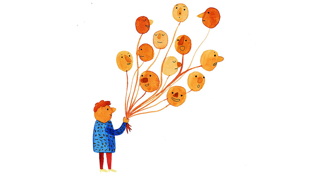 Man holding 13 orange balloons, each balloons has a different emotion (happy, sad, excited, mad) painted on it. Get anxiety treatment in Colorado at Catalyss Counseling, both online and in person counseling offered.
