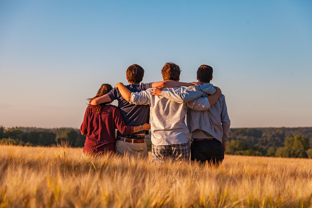 Group of happy people who benefitted from group therapy. Catalyss Counseling provides group and individual therapy in Colorado through online therapy and in person counseling in the Denver area 80209 and 80210