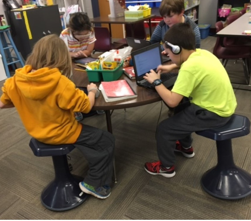 Students using new stools for studying