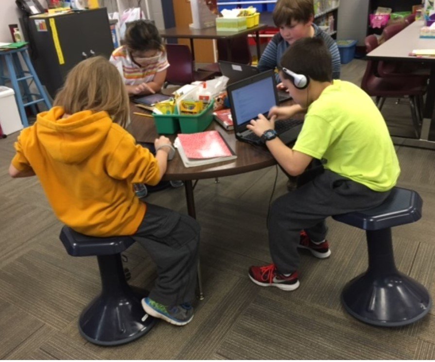 Students in innovative classroom.
