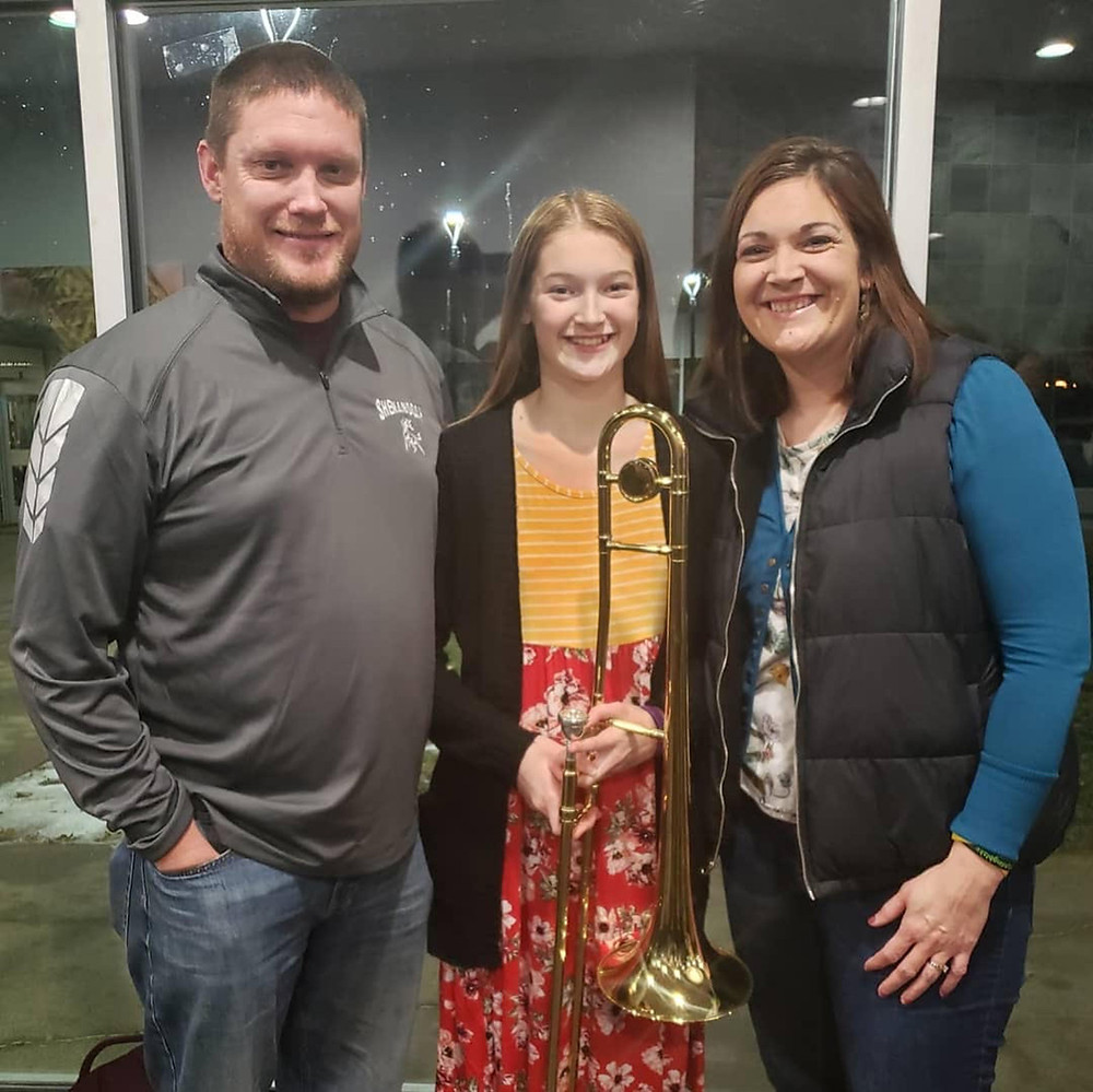 Jamie Burdorf with her husband and daughter.
