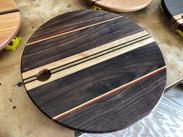 Round cutting board, charcuterie board.