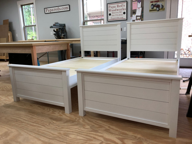 Two twin shiplap beds.