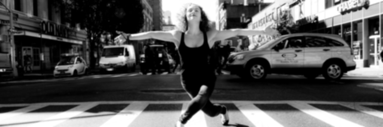 Woman in dancing pose on the street in New York