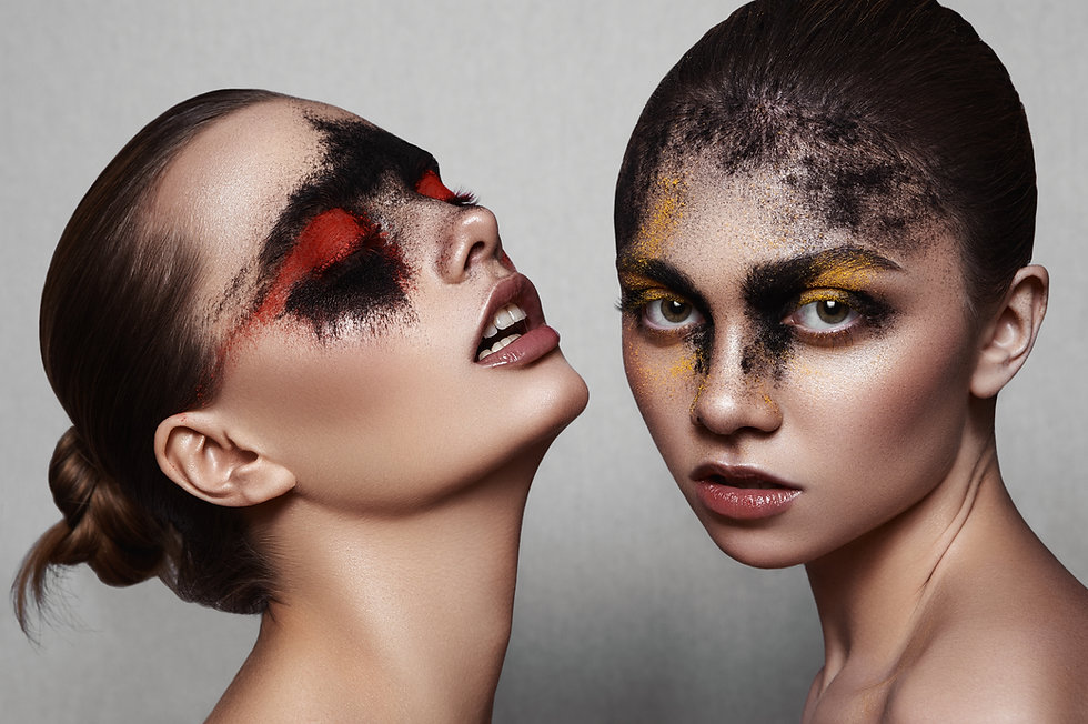 two girls with make-up on their faces tpca