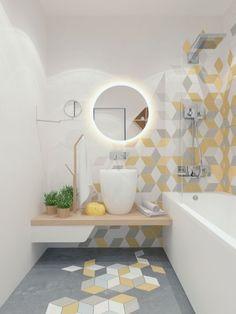 Keltaisen sävyisiä laattoja ja harmaita ja valkoisia laattoja on sekoitettu harmaaseen lattiaan ja valkoisille lattioille. Laatoitus ikään kuin kiipeää lattialta yhteen seinänurkkaukseen.