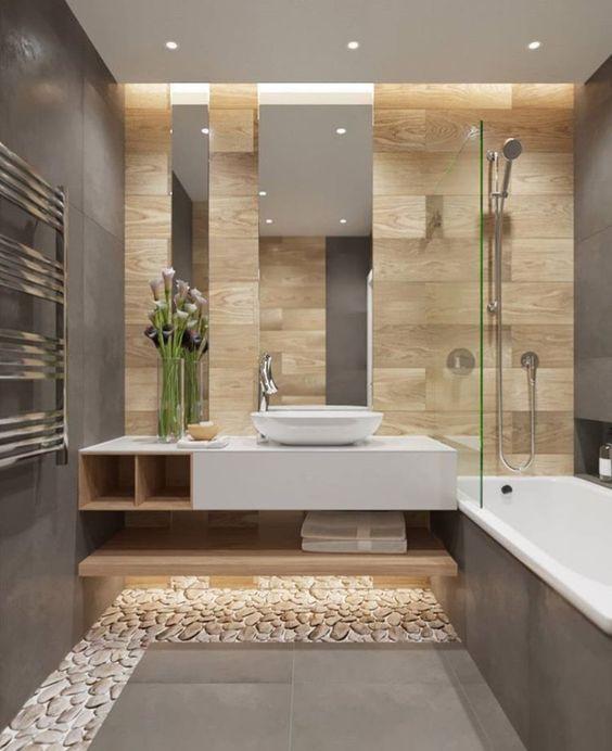 Kylpyhuoneen lattiassa on osittain pientä kiveä, osittain laatoitusta.