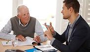 1140-senior-man-talking-younger-man-elde