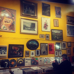 Not only is Speaking Volumes chock full of books and records, but our walls are dripping with art! V