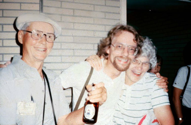 From left to right: Len Degen, Yogi Reppmann, and Virginia, 1983, Hamburg Airport. 42 farmers from Holstein, Iowa, had just arrived under the leadership of Virginia. We welcomed the ladies with red roses, and the men with a native brew, Flensburg Beer. Dee Eicke and Yogi Reppmann, graduate students at the time, traveled with their American friends on the tracks of their ancestors in Germany's northernmost state of Schleswig-Holstein.
