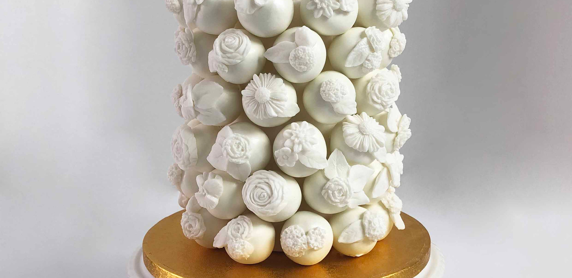 White Floral Celebration  Cake Pop Cake