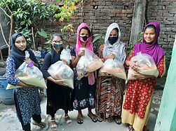 Sponsored girls receive extra food for their families