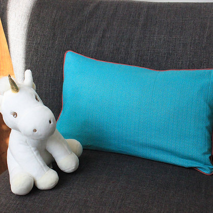 Coussin turquoise motif chevrons